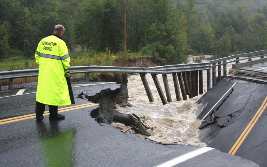 Bennington Police Chief Paul Doucette looks at a collapsed bridge on Route 9 in Woodford, Vt. on Sunday, Aug. 28, 2011. The remnants of Hurricane Irene dumped torrential rains on Vermont on Sunday. (AP Photo/Bennington Banner, Austen Danforth)