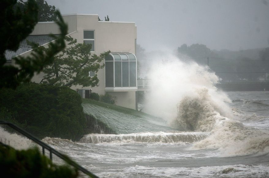 Waves crash over waterfront condominiums in the Fort Trumbull section of Milford, Conn. Sunday Aug. 28, 2011.  (AP Photo/The Connecticut Post, Brian A. Pounds)