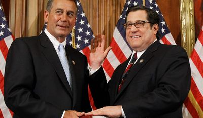 ** FILE ** House Speaker John A. Boehner (left), Ohio Republican, participates in a ceremonial House swearing-in ceremony for Rep. Steve Rothman, New Jersey Democrat, on Capitol Hill in Washington on Wednesday, Jan. 5, 2011. (AP Photo/Alex Brandon)