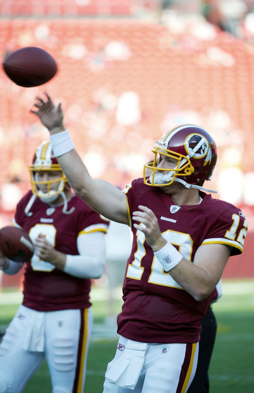 ROD LAMKEY JR./THE WASHINGTON TIMES Redskins quarterbacks John Beck (12) and Rex Grossman (8) have left outside observers with positive impressions as Week 1 draws near.