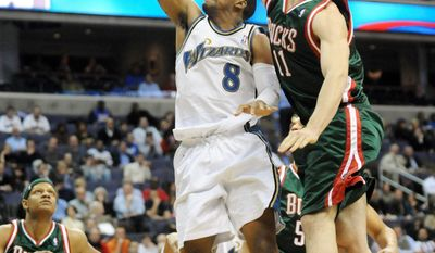 associated press Javaris Crittenton (8) , shown against Milwaukee in a 2009 game, is wanted in connection with the shooting death of 22-year-old Jullian Jones.