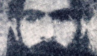 **FILE** This undated file photo reportedly shows the Taliban supreme leader Mullah Omar. (Associated Press)