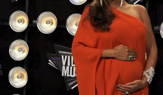 Beyonce arrives at the MTV Video Music Awards in Los Angeles on Aug. 28, 2011. (Associated Press)