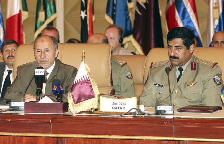 Mustafa Abdul-Jalil (left), head of the Libyan rebels' National Transitional Council, and Major Gen. Hamad bin Ali al-Attiyah, Qatari chief of staff, look on during NATO talks in Doha, Qatar, on Monday, Aug. 29, 2011. (AP Photo/Osama Faisal)