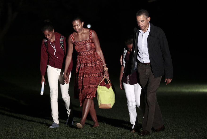 President Obama, first lady Michelle Obama and their daughters Malia (left) and Sasha walk across the South Lawn of the White House on Aug., 26, 2011, after a family vacation on Martha's Vineyard. (Associated Press)