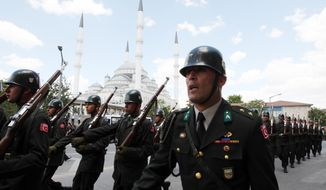 **FILE** In this photo from July 24, 2010, Turkish soldiers march after a funeral ceremony for captain Ibrahim Baris Yurtseven, an army officer who was killed by Kurdish rebels in Hakkari at Turkey-Iraq border, at the Kocatepe Mosque in Ankara, Turkey. (Associated Press)
