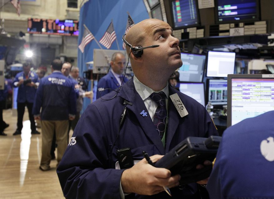 Trader Fred Demarco (right) works on the floor of the New York Stock Exchange on Monday, Aug. 29, 2011, in New York. (AP Photo/Richard Drew)