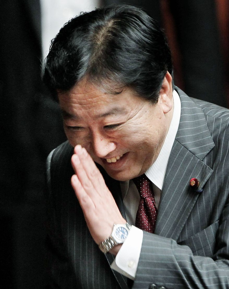 ASSOCIATED PRESS Yoshihiko Noda reacts before Japan's lower house elected him as the country's new prime minister at the parliament in Tokyo on Tuesday.