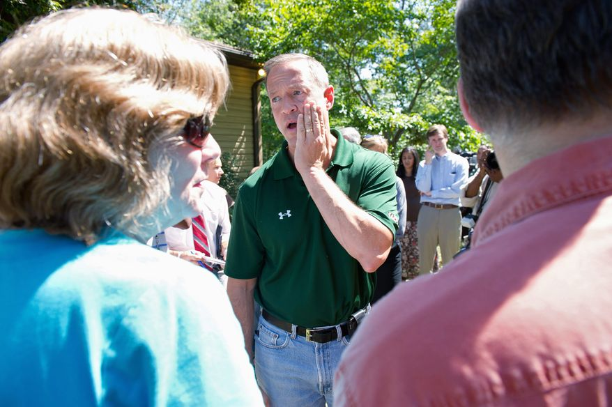 "Maryland Gov, Martin O'Malley listens Tuesday to Mike and Beth Adams describe the damage to their home from Hurricane Irene along Whiskey Creek Lane in Hollywood, Md. ""One of the things that you have to see to believe is the sheer volume of big, heavy trees that have been knocked down,"" Mr. O'Malley said. (Andrew Harnik/The Washington Times)"