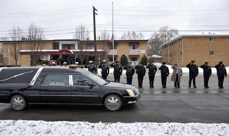 "** FILE ** In this Wednesday, Dec. 22, 2010, picture, a hearse containing the body of U.S. Border Patrol officer and former U.S. Marine Brian Terry drives past a line of law enforcement officers from various departments lined up along Seven Mile Road outside Greater Grace Temple in northwest Detroit after Terry's funeral service. The ATF is under fire over a Phoenix-based gun-trafficking investigation called ""Fast and Furious,"" in which agents allowed hundreds of guns into the hands of straw purchasers in hopes of making a bigger case. Two of those weapons were found in December at the fatal shooting of the Border Patrol agent. (AP Photo/The Detroit News, John T. Greilick)"