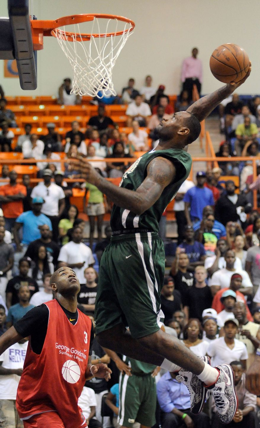 LeBron James, right, of the Miami Heat, dunks against Jarrett Jack, left, of the New Orleans Hornets, during a charity basketball game hosted by Carmelo Anthony of the New York Knicks, Tuesday, Aug. 30, 2011, at Morgan State University in Baltimore. (AP Photo/Steve Ruark)