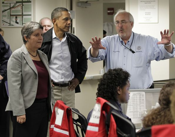President Obama listens to an update on the status of Hurricane Irene at Federal Emergency Management Agency (FEMA) headquarters in Washington on Aug. 27, 2011. He is joined by Secretary of Homeland Security Janet Napolitano (left) and FEMA director Craig Fugate (right). (Associated Press)