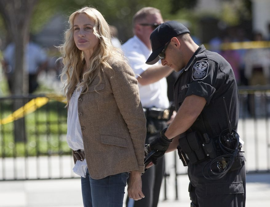 Actress Daryl Hannah is arrested by U.S. Park Police in front of the White House on Aug. 30, 2011, during a protest against the Keystone oil pipeline. (Associated Press)