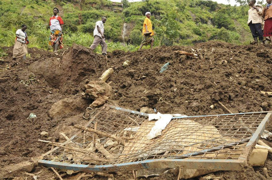 A broken bed lies in the mud in Gombe village in the Bulambuli district of Uganda, about 175 miles from the  capital, Kampala, on Tuesday, Aug. 30, 2011. Landslides killed at least 40 people on Monday, including children buried in their homes, officials said. (AP Photo/Stephen Wandera)