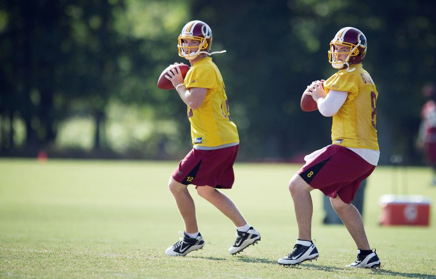 PASSING FANCY: Washington Redskins quarterbacks Rex Grossman (8) and John Beck (12) take part in passing drills during training camp at Redskins Park in Ashburn, Va., on Wednesday. One will be the starting quarterback; the other will take a seat on the bench. (Rod Lamkey Jr./The Washington Times)