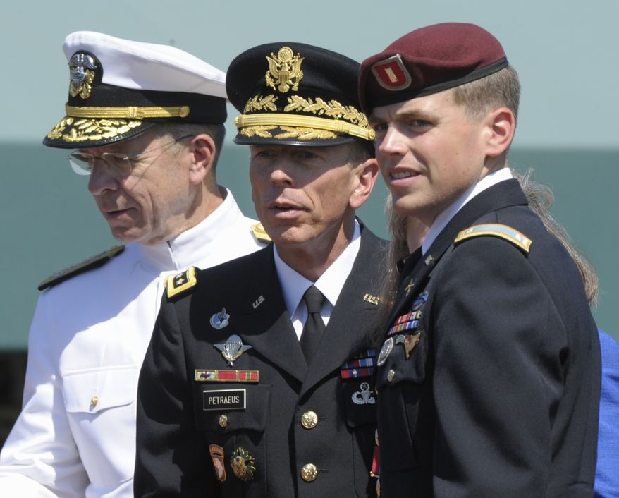 Adm. Mike Mullen (left), chairman of the Joint Chiefs of Staff, stands with (from second from left) U.S. Army Gen. David H. Petraeus; Holly Petraeus (partially hidden), the general's wife; and 2nd Lt. Stephen Petraeus, Gen. and Mrs. Petraeus' son, during an armed forces farewell tribute and retirement ceremony for the general on Wednesday, Aug. 31, 2011, at Joint Base Myer-Henderson Hall in Arlington. (AP Photo/Susan Walsh)
