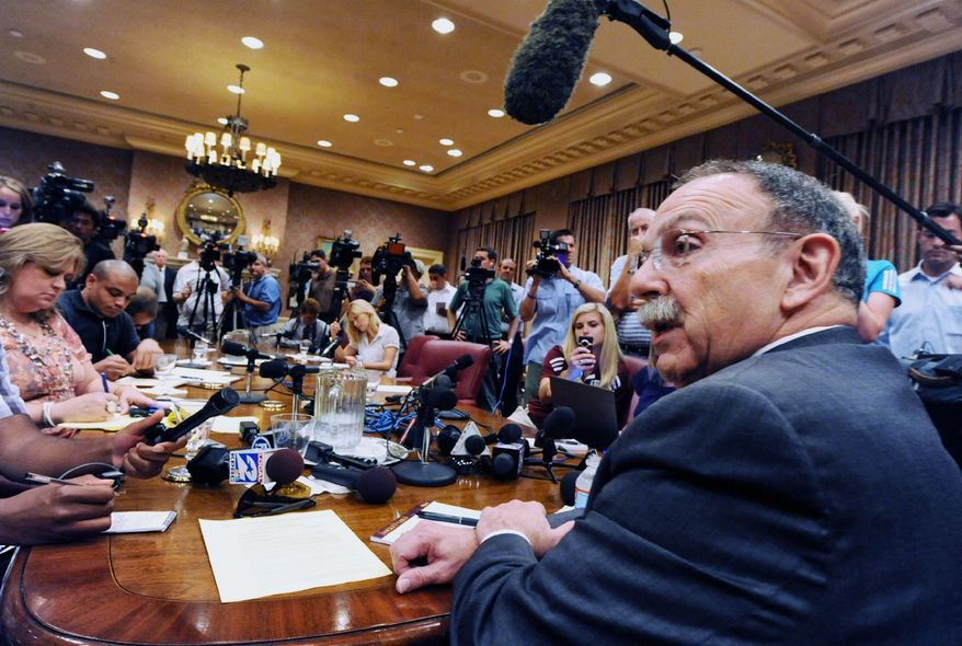Texas A&M president R. Bowen Loftin addresses members of state and national media in the A&M Board of Regents room in College Station, Texas, Monday, Aug. 15, 2011. (AP Photo/Bryan-College Station Eagle, Dave McDermand)
