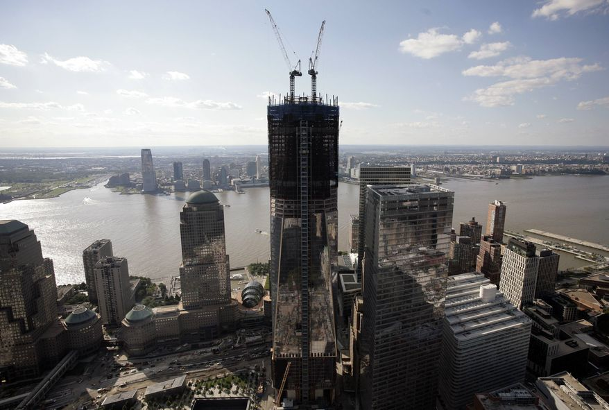 One World Trade Center rises above the lower Manhattan skyline in this aerial photo, Tuesday, Aug. 30, 2011, in New York. Behind the tower are the Hudson River and New Jersey. Sept. 11, 2011, will mark the 10th anniversary of the terrorist attacks in the United States. (AP Photo/Mark Lennihan)