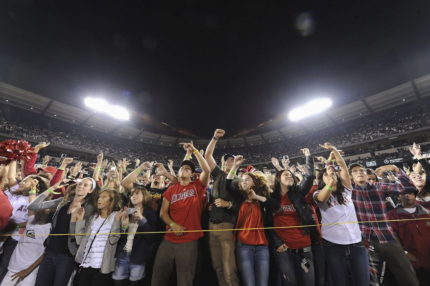 Fans cheer as Taio Cruz performs at Angel Stadium on June 11. Country superstar Dierks Bentley and Ludacris also performed there this year. (Associated Press)
