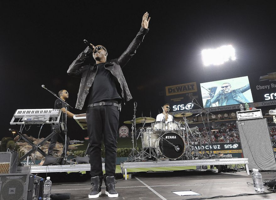 Taio Cruz brought fans out to the ballpark when he sang at Angel Stadium in Anaheim, Calif., home of the Los Angeles Angels, in June. (Associated Press)