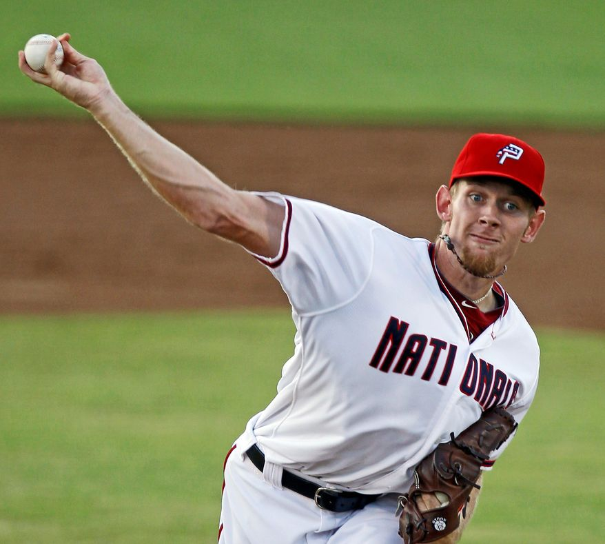 ** FILE ** Washington Nationals pitcher Stephen Strasburg, shown with Class A Potomac, struck out four in six innings Thursday night for Class AA Harrisburg in his final rehab start. He's slated to pitch against Los Angeles at Nationals Park on Tuesday. (Associated Press)