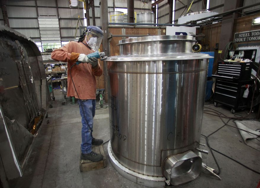 ** FILE ** Roddy Morris polishes a tank at JV Northwest, a manufacturer of stainless steel vessels in Canby, Ore., on Tuesday, Aug. 30, 2011. (Associated Press)