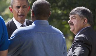 President Obama greets Hector Sealey (center), safety director for Ft. Myer Construction Corporation, and AFL-CIO President Richard Trumka (right) after speaking at the White House on Aug. 31, 2011, to urge Congress to pass a federal highway bill. (Associated Press)