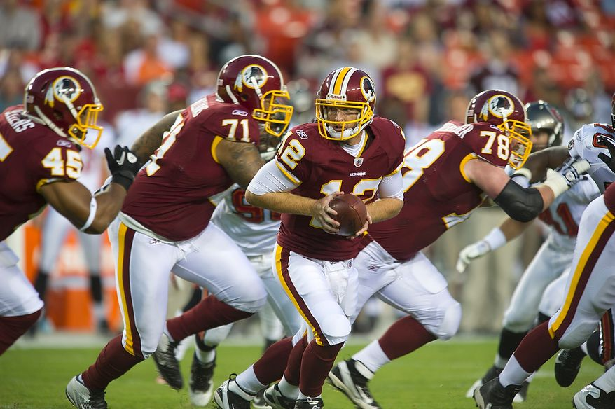 ** FILE ** Washington Redskins John Beck rolls out to hand the ball off against the Tampa Bay Buccaneers in the first quarter at FedEx Field in Landover, Md., Thursday, Sept. 1, 2011, in the last preseason game. (Rod Lamkey Jr./The Washington Times)