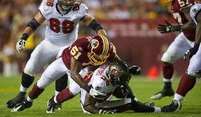 Keyaron Fox of the Washington Redskins (51) brings down Allen Bradford of the Tampa Bay Buccaneers (38) late in the first quarter at FedEx Field in Landover, Md., Thursday, September 1, 2011, in the last pre-season game. (Rod Lamkey Jr./The Washington Times)