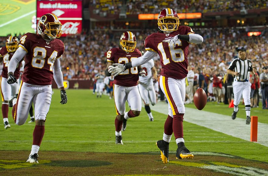 Washington Redskins wide receiver Brandon Banks (16) celebrates his 95 yard kick off return touchdown against the Tampa Bay Buccaneers in the second quarter at FedEx Field in Landover, Md., Thursday, September 1, 2011, in the last pre-season game. (Rod Lamkey Jr./The Washington Times)