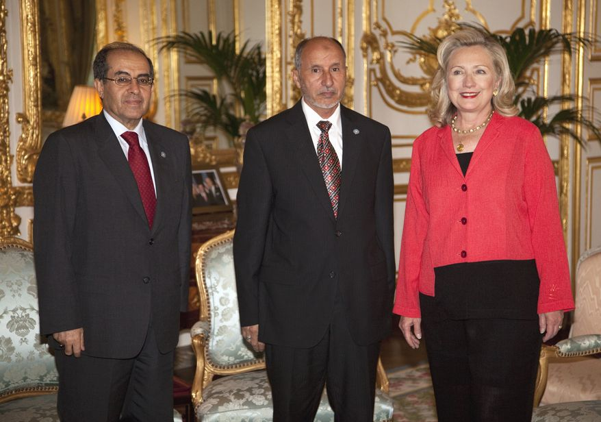 U.S. Secretary of State Hillary Rodham Clinton meets with Libyan Transitional National Council Chairman Mustafa Abdel Jalil (center) and Libyan Transitional National Council Prime Minister Mahmoud Jibril on Thursday, Sept. 1, 2011, in Paris. (AP Photo/Evan Vucci, Pool)
