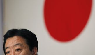 In this photo from Aug. 29, 2011, Yoshihiko Noda, new leader of the ruling Democratic Party of Japan, speaks during a press conference shortly after his election at a voting by the party lawmakers in Tokyo. (Associated Press)