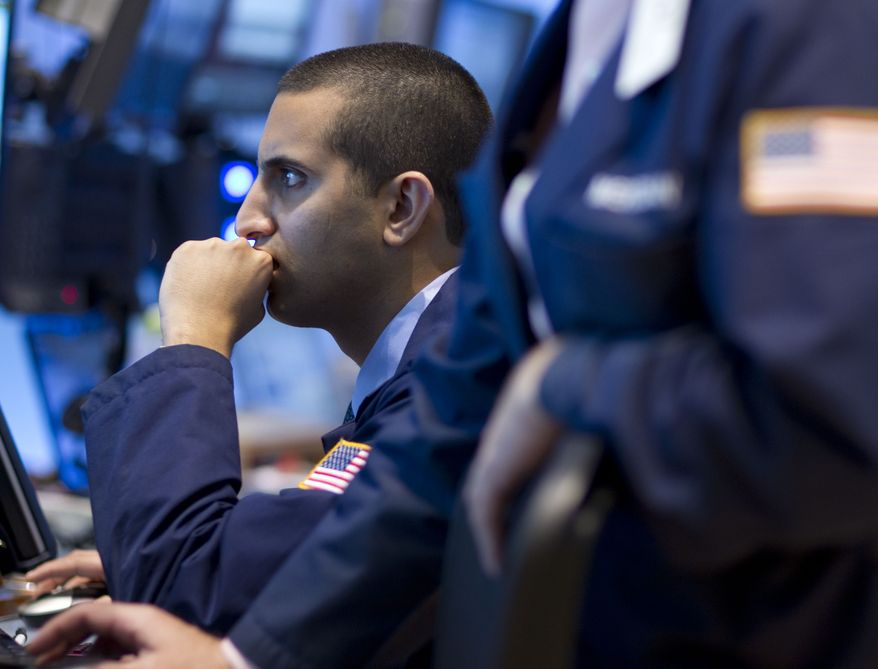 A trader works Sept. 2, 2011, on the floor of the New York Stock Exchange on in New York. (Associated Press)