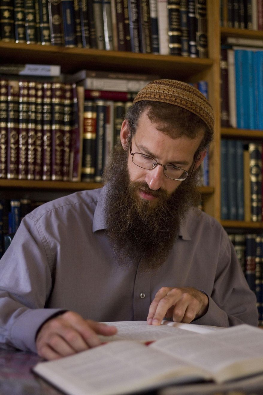 In this Aug. 31, 2011, photo, Rabbi Arele Harel studies in his home in the West Bank Jewish settlement of Shiloh, near Nablus. (AP Photo/Ariel Schalit)