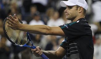 Andy Roddick, of the United States, acknowledges the crowd after defeating Jack Sock, also of the United States, 6-3, 6-3, 6-4 during the U.S. Open tennis tournament in New York, Friday, Sept. 2, 2011. (AP Photo/Charles Krupa)