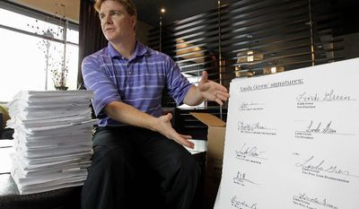 """ASSOCIATED PRESS Jeff Thigpen, a registrar in Guilford County, N.C., shows a group of signatures on loan documents all """"signed"""" by one person in Charlotte, N.C. Counties across the United States are discovering that illegal or questionable mortgage paperwork is far more widespread than first thought."""