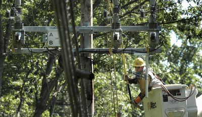 ASSOCIATED PRESS Baltimore Gas & Electric contractor Nate Mickel of Altoona, Pa., works on a power line in Annapolis the day Hurricane Irene hit.