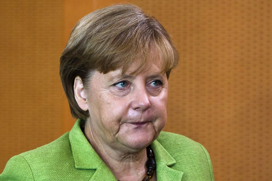 ** FILE ** German Chancellor Angela Merkel arrives for the weekly Cabinet meeting at the Chancellery in Berlin on Wednesday, June 29, 2011. (AP Photo/Markus Schreiber, File)