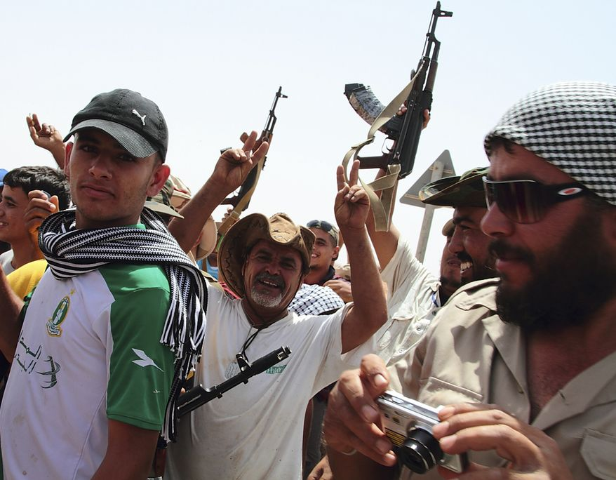 Rebel fighters celebrate in the desert outside a military base near Bani Walid, Libya, on Saturday, Sept. 3, 2011. More than a hundred armed vehicles left from Misrata rebel outposts Saturday morning on a mission to overtake a loyalist army ground forces base near Bani Walid, a stronghold of Col. Moammar Gadhafi. (AP Photo/Gaia Anderson)