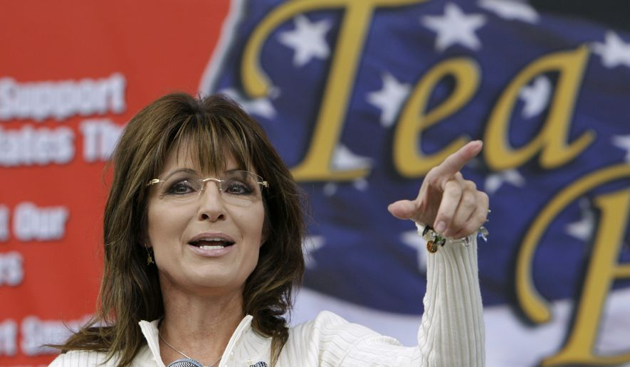 Former Alaska Gov. Sarah Palin speaks to tea party supporters during at a rally in Indianola, Iowa, on Saturday, Sept. 3, 2011. (AP Photo/Charlie Neibergall)