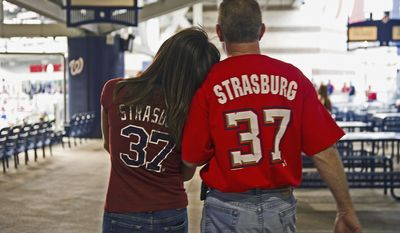 Photographs by Barbara L. Salisbury/The Washington Times Tammy Hill of Woodbridge, Va., and Roger Harris of Catlett, Va., sport Washington Nationals jerseys bearing the name of pitcher Stephen Strasburg at Nationals Stadium on Friday. Strasburg returns to the majors Tuesday after elbow surgery.