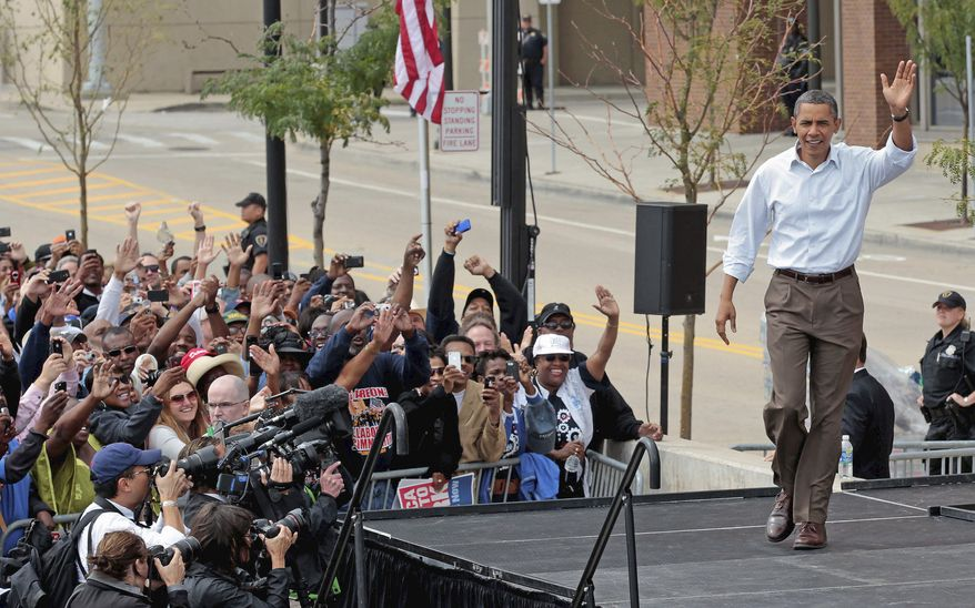 """""""Giving everybody a shot, everybody a chance to share in America's prosperity, from the factory floor to the boardroom. That's what unions are all about,"""" President Obama told a rally in Detroit Monday following a parade of union workers on Labor Day. He said his administration is """"fighting for good jobs with good wages."""" (Associated Press)"""