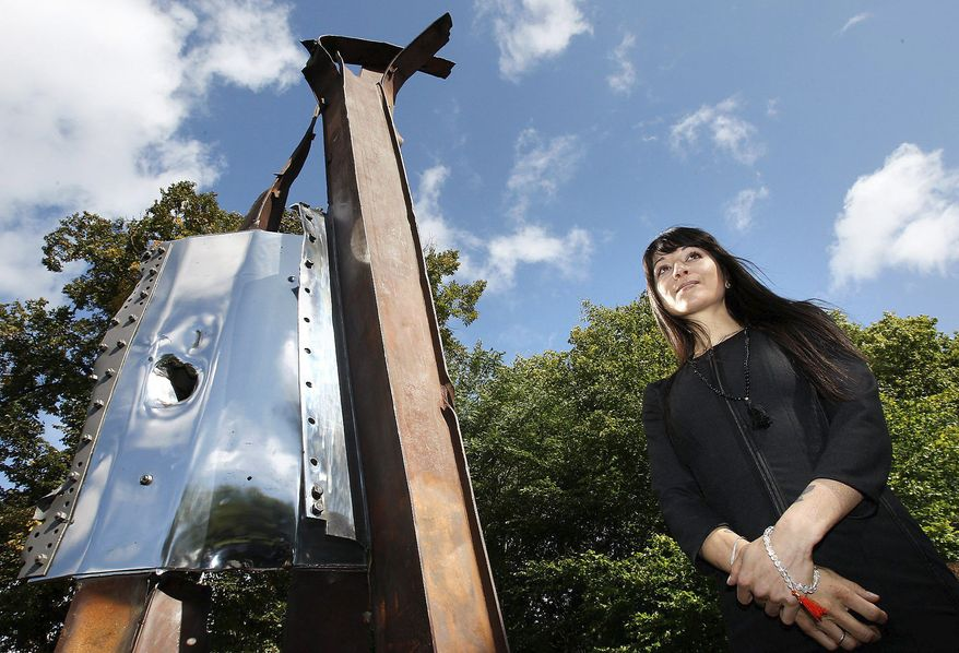"New York artist Miya Ando shows her sculpture made from steel recovered from the remnants of the twin towers. ""After 9/11"" was commissioned by the 911 London Project. (Associated Press)"