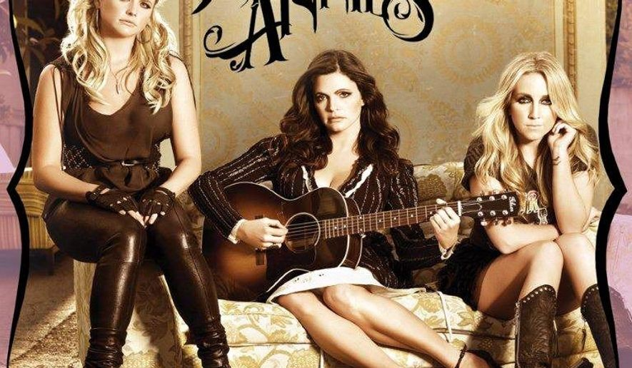 """In this CD cover image released by Columbia Nashville, the latest release by the Pistol Annies, """"Hell on Heels,"""" is shown. (AP Photo/Columbia Nashville)"""