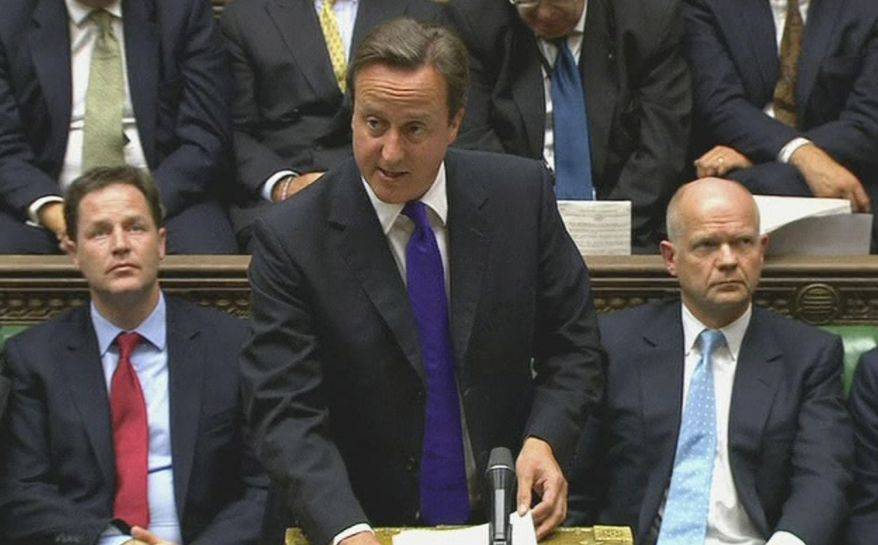British Prime Minister David Cameron speaks in the House of Commons in London on Monday, Sept. 5, 2011, about an inquiry into allegations of cozy ties between U.K. intelligence and Col. Moammar Gadhafi's regime.  (AP Photo/Parliamentary Recording Unit via Associated Press Television News)
