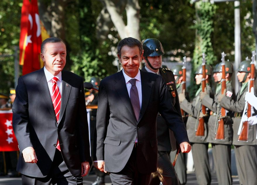 """@Subhead.frcd.22:""""That report does not mean anything for us. We will determinedly maintain this process. Diplomatic relations will be downgraded as of tomorrow, trade relations, military relations have been suspended."""" @PullQuoteSig:-Recep Tayyip Erdogan (left), Turkey's prime minister"""