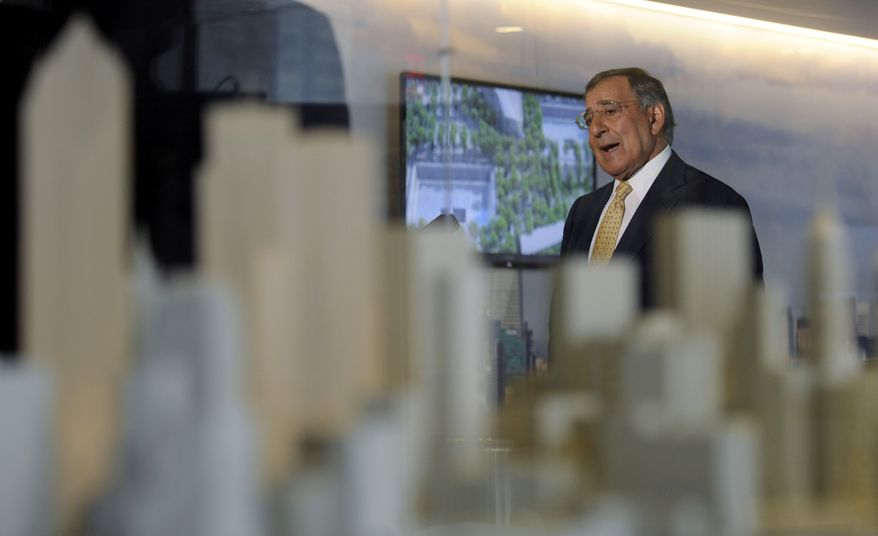 With a model of New York in the foreground, Defense Secretary Leon E. Panetta speaks to reporters after touring the National September 11 Memorial & Museum in New York on Tuesday, Sept. 6, 2011. (AP Photo/Susan Walsh, Pool)