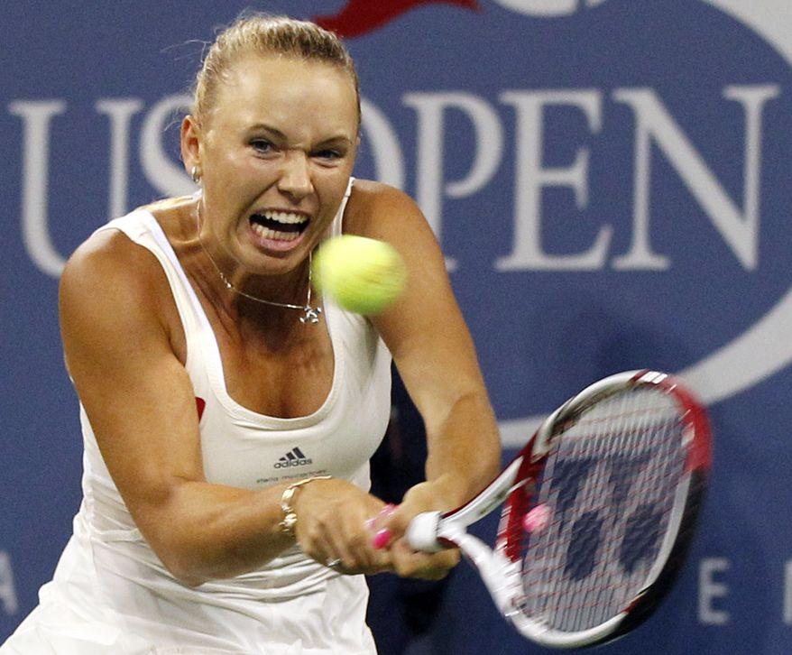 Caroline Wozniacki, of Denmark, returns to Svetlana Kuznetsova, of Russia, in the fourth round of the U.S. Open tennis tournament, Monday, Sept. 5, 2011, in New York. (AP Photo/Elise Amendola)