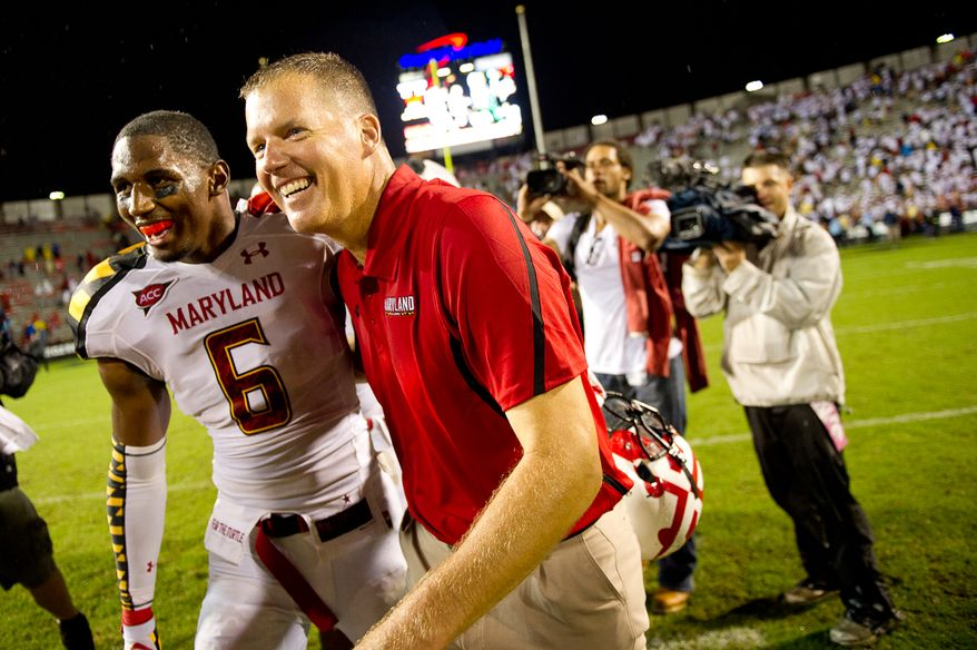 Head coach Randy Edsall and linebacker Kenny Tate (6) of the Maryland Terps hug near midfield after their 32-24 win over the Miami Hurricanes at Byrd Stadium at the University of Maryland in College Park, MD, Monday September 5, 2011. (Andrew Harnik / The Washington Times)