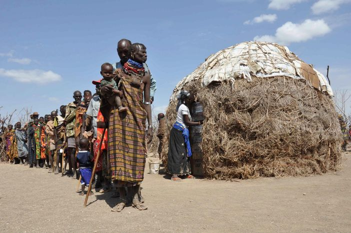 Associated Press Turkana people wait in line to receive food from a famine-relief charity in Turkana district, Kenya, on Aug. 30. The U.N. says tens of thousands already have died in Somalia, Kenya, Ethiopia and Djibouti owing to famine.